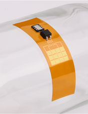 The implant contains a flexible piezoelectric film and a tiny rechargeable battery. (Credit: John Rogers, University of Illinois)