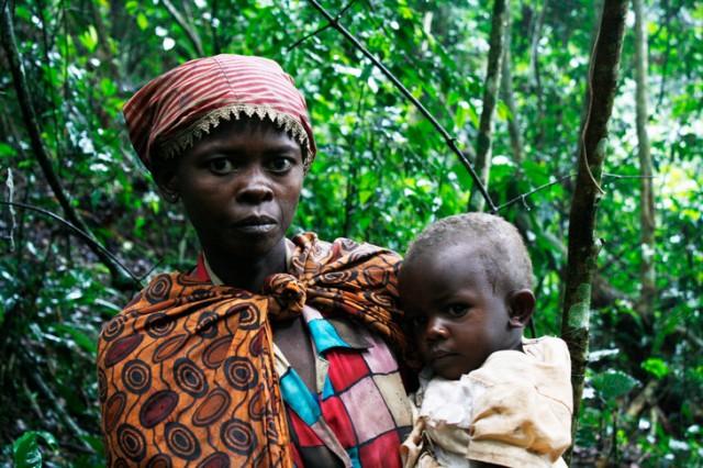 Batwa young woman and child