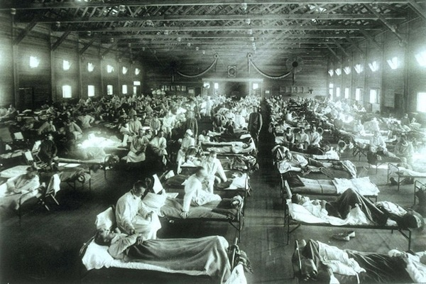 Soldiers from Fort Riley, Kansas, ill with Spanish influenza in a hospital ward at Camp Funston. The 1918 pandemic was one of history's most devastating outbreaks of disease, resulting in an estimated 40 million deaths. Photo: U.S. Army